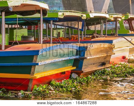 Traditional old wooden boats at the Chao Phraya River. Bangkok, Thailand