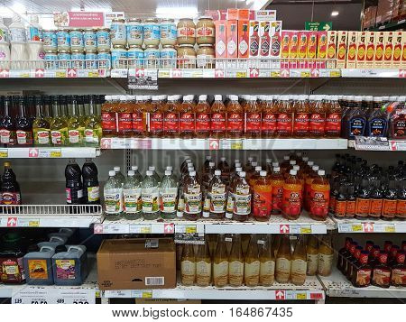 CHIANG RAI THAILAND - NOVEMBER 29 : various brand of vinegar on supermarket stand or shelf on November 29 2016 in Chiang rai Thailand.