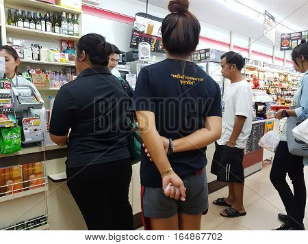 CHIANG RAI THAILAND - NOVEMBER 29 : unidentified people at supermarket cashiers before going out on November 29 2016 in Chiang rai Thailand.