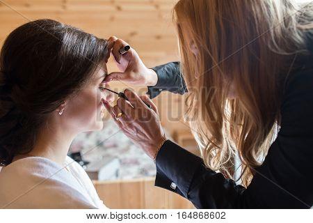 Closeup of a makeup artist at work
