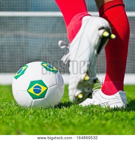 Penalty kick with Brazilian flag ball, toned image