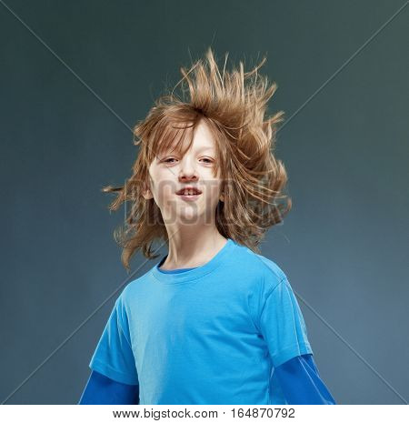 Portrait of a Boy with his Hair Flying in the Air