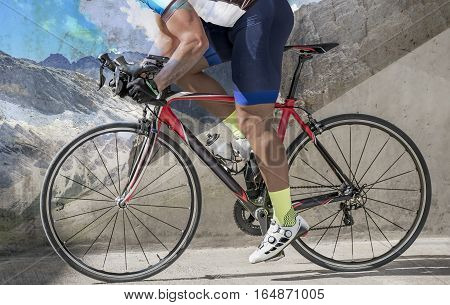 Side view photo of an attractive race biker biking in front of a concrete wall. The background mountain gradient overlays parts of the bike and the bicylist.