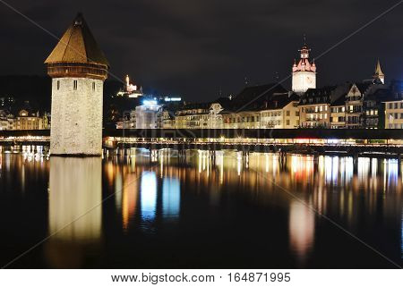 Chapel bridge ancient fort and travel location in Lucerne Switzerland