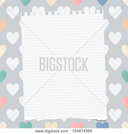 White ripped ruled notebook, copybook, note paper stuck on pattern created of heart shapes.