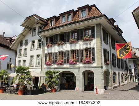THUN, SWITZERLAND, JULY 28, 2016: The attractive facade of 17th century townhall of Thun, a town in the Bernese Oberland in Switzerland. It is a popular tourist destination.