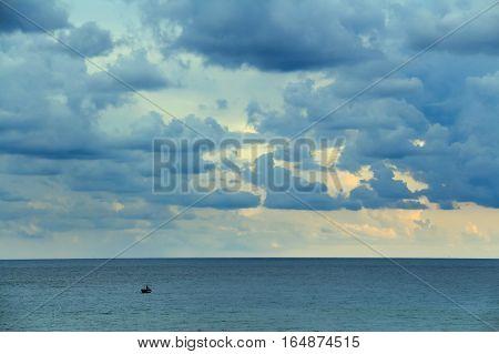 Seascape with fisherman boat in Mediterranean sea near shore of Tunisia