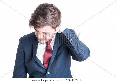 Portrait Of Business Man Having A Neck Or Head Ache