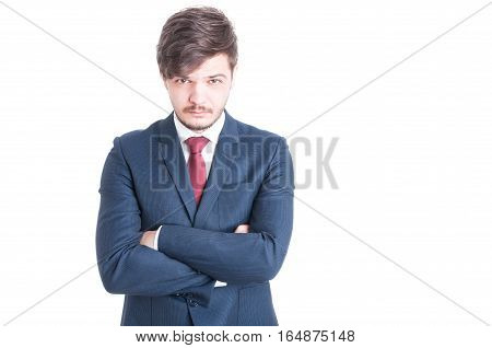 Young Man Wearing Suit Posing With Arms Crossed