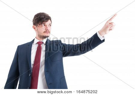 Portrait Of Business Man Showing Something With Index Finger