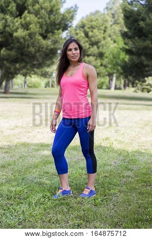 Beautiful Woman doing stretching exercices in the park