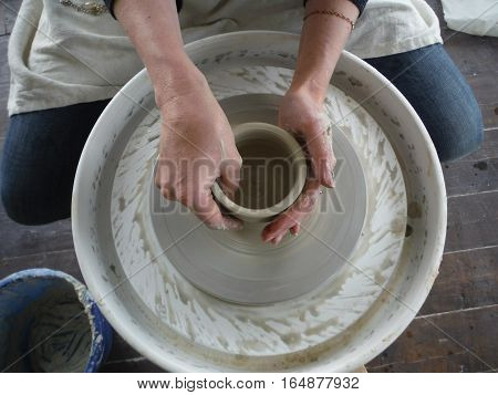 profession and Hobbies: working on the Potter's wheel, molding a pitcher