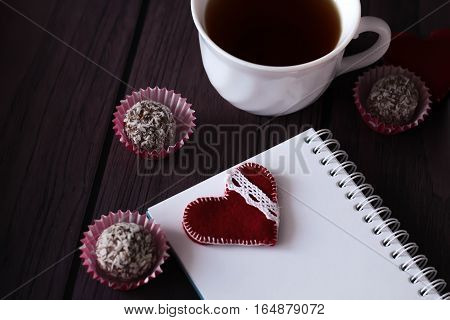 Chocolate Balls And Notebook With Bookmark