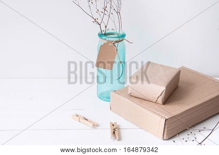 Minimal elegant composition with turquoise vase and craft boxes for blogs, shops and social media