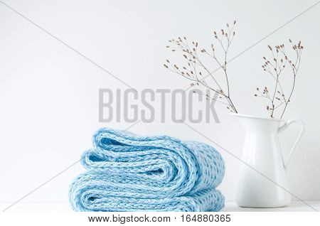 Minimal elegant composition with blue scarf and white vase for blogs, shops and social media