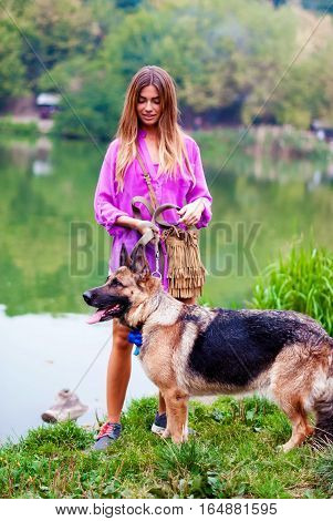 Girl with a German shepherd. Woman with dog.