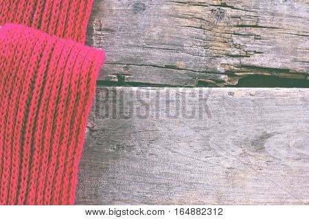 nitted plaid sweater on old wooden boards. Cosy soft winter background knitted sweater. Christmas holidays at home. place for text Top view flat lay with copy space for slogan or text message