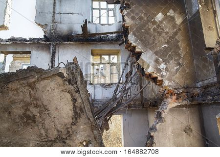 Ruined House Inside with rotten floor and holes in a wall