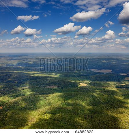 Aerial view of the forest of the hills in cloudy day in summer.