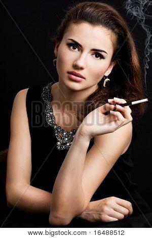 beautiful woman smokes a cigarette