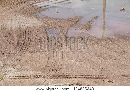 Wheel track on the mud soil which has water in floor