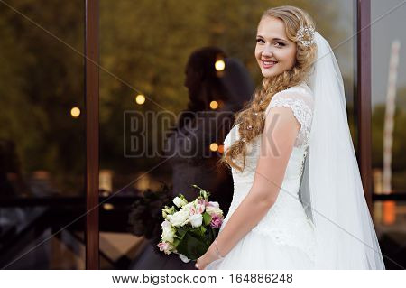 Starting new life today. Portrait of a gorgeous young bride smiling to the camera cheerfully