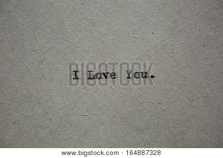 Top view fo message I love you printed on typewriter machine. Copy space on fiber paper.