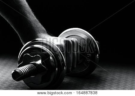 The human hand rising barbell with pads.