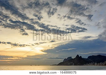 Sunset at Arpoador Ipanema and Leblon beaches in Rio de Janeiro with the hill Two brothers and Gávea stone in the background