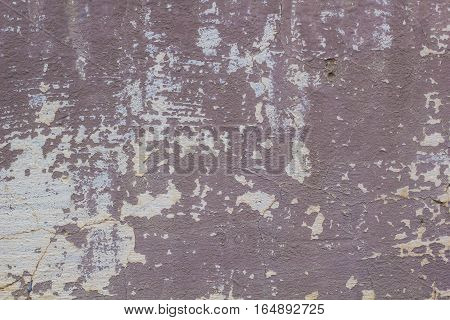 chipped paint on an old plaster wall abstract concrete weathered with cracks and scratches great background or texture