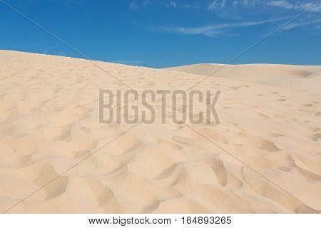 Footprint On White Sand Dune Desert In Mui Ne, Vietnam