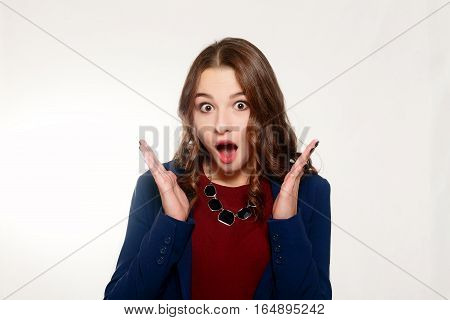 emotions people beauty and lifestyle concept - Portrait of young woman with shocked facial expression