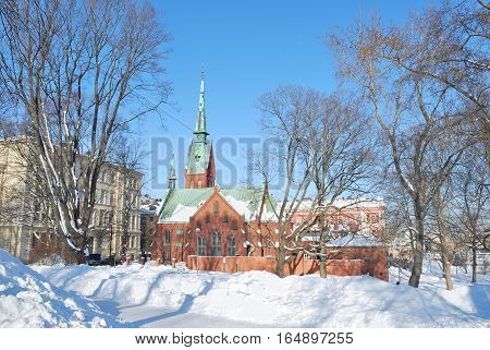 Helsinki Finland. Beautiful park and the German church in a sunny winter day
