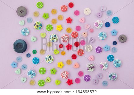 Variety of colorful buttons on a purple background