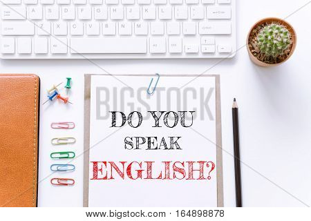 Text Do you speak english on white paper background / business concept