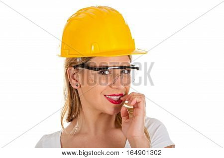 Picture of a sexy young woman wearing a yellow helmet - isolated background