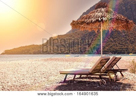 Sunshades And Chaise Lounges On Beach. Summer Seascape.