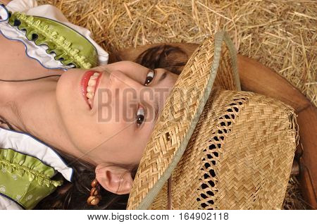 Portrait of a smiling girl in the hayloft
