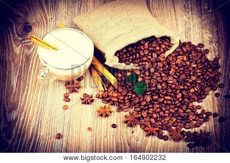 Cup of coffee on wooden background. Toned image