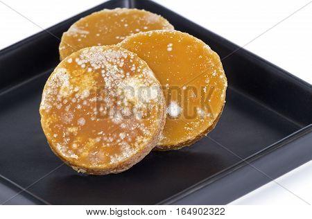 Sliced Brown Coconut Sugar On Black Dish