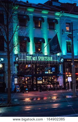 Sportsbar O´Learys on the Avenue in Gothenburg night shot with illuminated building in turquoise neon lights Gothenburg, Sweden 2016-11-22