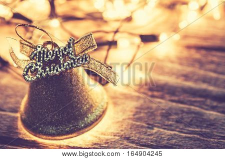 Christmas background with Christmas decoration shine bells with ribbon bows on a wooden table background with copy space Grunge style