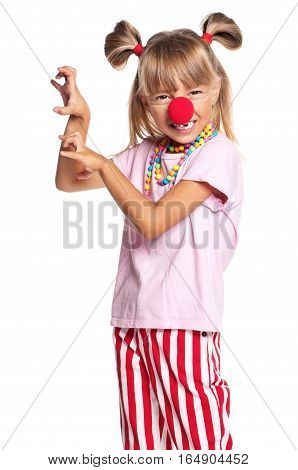 Portrait of happy little girl with red clown nose, isolated on white background