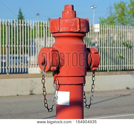 Red fire hydrant water pipe near the road. Fire hydrant for emergency fire access