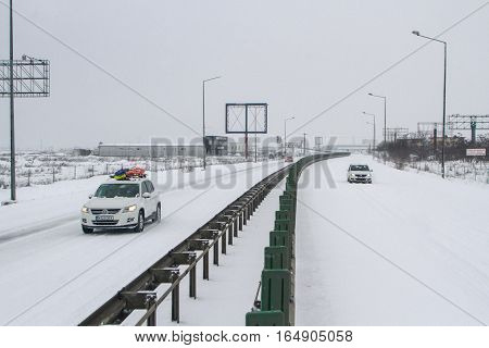 Highway 2 Romania December 29 2014: Cars are passing on the highway A2 the main commercial route which connects Bucharest to the Black Sea's port Constanta.
