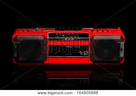 Vintage red boom box on black background
