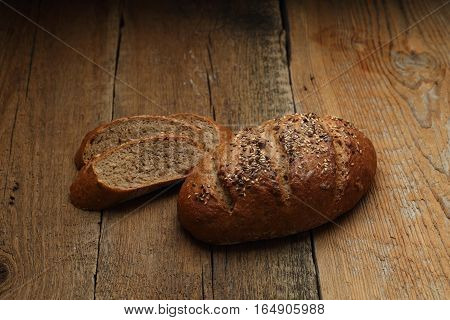 Bread And Slices On Dark Wooden Background