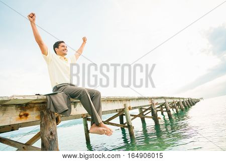 businessman by the sea, enjoying his time away from the office