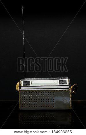 70s Vintage radio on black background .