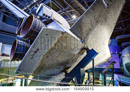 KENNEDY SPACE CENTER, FLORIDA, USA - APRIL 21, 2016: Several rockets are exhibited in the visitor complex of Kennedy Space Center near Cape Canaveral in Florida. Atlantis space shuttle pavilion.